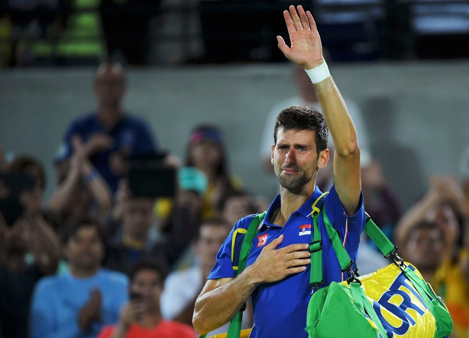 2016 Rio Olympics - Tennis - Preliminary - Men's Singles First Round - Olympic Tennis Centre - Rio de Janeiro, Brazil - 07/08/2016. Novak Djokovic (SRB) of Serbia reacts after losing his match against Juan Martin Del Potro (ARG) of Argentina. REUTERS/Toby Melville TPX IMAGES OF THE DAY. FOR EDITORIAL USE ONLY. NOT FOR SALE FOR MARKETING OR ADVERTISING CAMPAIGNS.